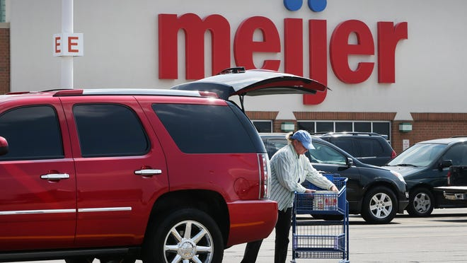 A shopper puts purchases in her car after shopping at Meijer, 8375 E. 96th St., Indianapolis, on Tuesday, September 8, 2015.