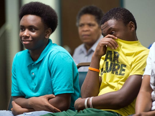 Mikaylo Luster, left, and brother Mekhi Luster attend a forum at Emerald Youth Foundation on Tuesday, March 15, 2016 about hip hop's influence on society and culture. A panel of three high school students and one college student answered questions and talked about topics ranging from bullying to social media.