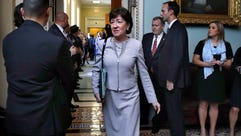 Sen. Susan Collins, R-Maine, center, leaves a meeting