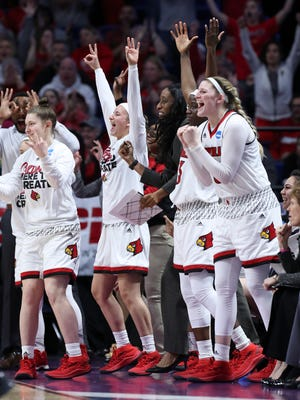 The Louisville bench celebrate a play during their NCAA Elite 8 matchup at Rupp Arena in Lexington.    