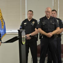 From left, newly sworn Burlington police officers David Murrish, Zachary Beal, Jordan Peterson, and Cory Campbell. All four were sworn in as officers during a ceremony at the police department on Thursday.