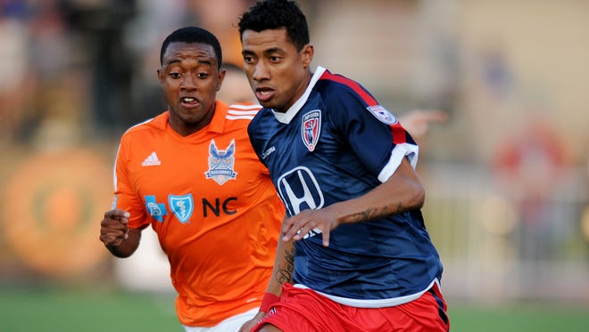 Indy Eleven midfielder Kleberson brings the ball up field against the Carolina RailHawks at Carroll Stadium, Saturday, April 12, 2014, in Indianapolis.