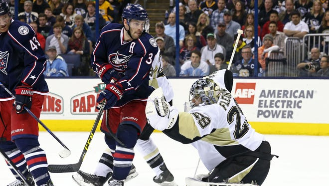 Pittsburgh Penguins goalie Marc-Andre Fleury (29) makes a glove save against Columbus Blue Jackets center Boone Jenner (38) in the second period at Nationwide Arena.