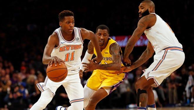 New York Knicks guard Frank Ntilikina (11) drives to the basket past Los Angeles Lakers guard Kentavious Caldwell-Pope.s
