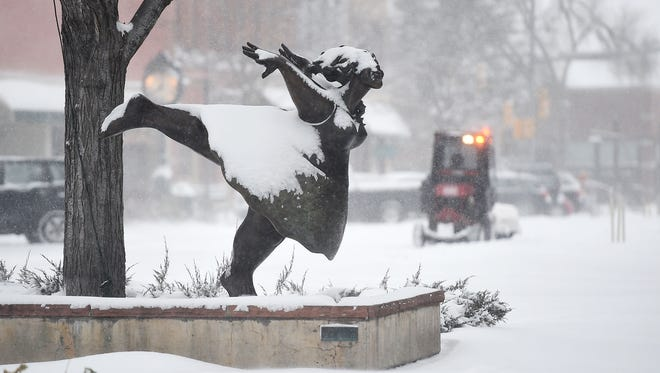 Heavy snow in Old Town Fort Collins on Tuesday, December 15, 2015.