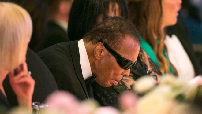 After a several year absence from Celebrity Fight Night, Muhammad Ali sits at the dais during Celebrity Fight Night at the JW Marriott Desert Ridge Resort and Spa in Phoenix on Saturday, April 9, 2016.Muhammad Ali is hospitalized in the Phoenix area with what two people familiar with his condition say may be more serious problems than his previous hospital stays.
