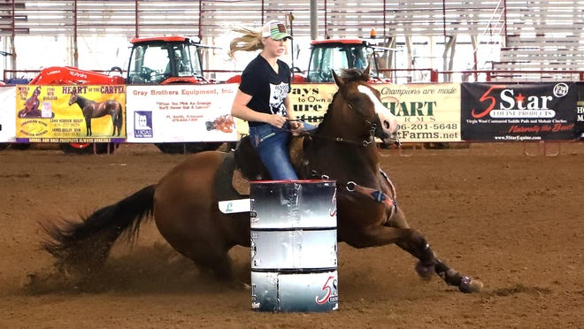 Lauren Whitmire of Sallisaw rides her horse, WR Famous Amigo, to a clean ride, Friday, July 31, 2020, in the time trials for a slot in The World's Richest Barrel Futurity and Super Derby finales, Saturday, August 1, 2020 in Harper Stadium at Kay Rodgers Park.