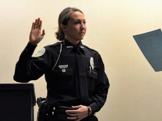 Henderson Mayor Steve Austin officially swears in Officer Ellie Steiner earlier this week.