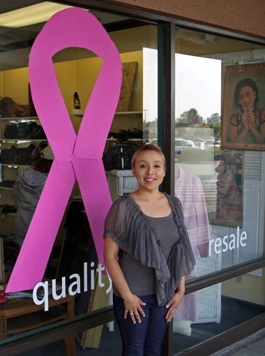 Lebrina Garcia, manager of the Discovery Shop, Salinas, stands at the entrance, Oct.17, 2017.