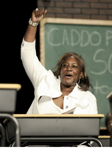 Lillian Priest, Caddo Parish School Board's first vice president, cheers as each school in the parish is recognized during the opening of the Caddo Parish Public Schools Back-to-School Kickoff Meeting at the Shreveport Convention Center on Thursday, Aug. 13, 2009. File/The Times