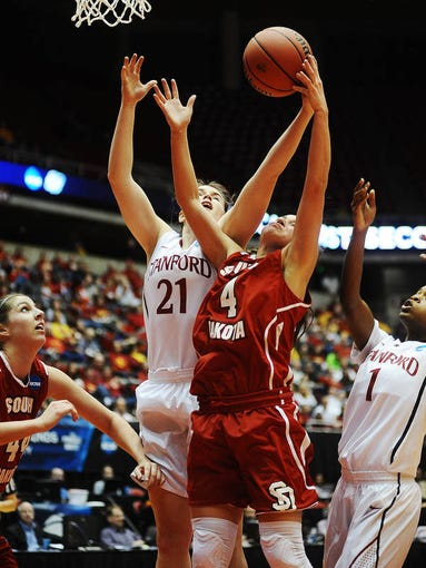 USD's Tia Hemiller (4) loses a rebound to Stanford's Sara James (21) during the first half of a NCAA Women's Basketball Tournament game on Saturday, March 22, 2014, at the Hilton Coliseum in Ames, Iowa. Stanford was up 42 to 27 after the first half.