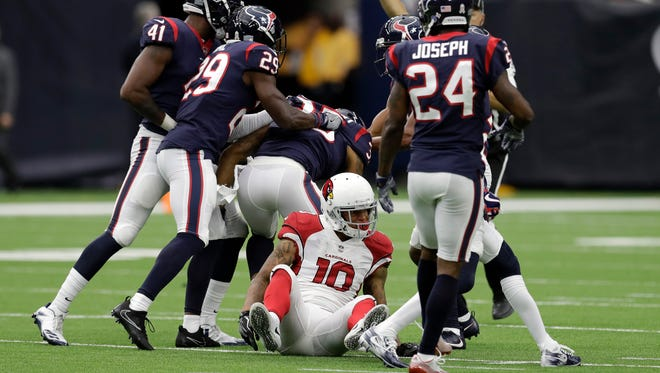 Houston Texans defenders celebrate defensive back Eddie Pleasant's interception over Arizona Cardinals wide receiver Brittan Golden (10) during the second half of an NFL football game Sunday,