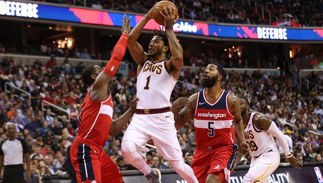 Cleveland Cavaliers guard Derrick Rose (1) shoots the ball as Washington Wizards guard John Wall (2) defends in the third quarter at Capital One Arena.
