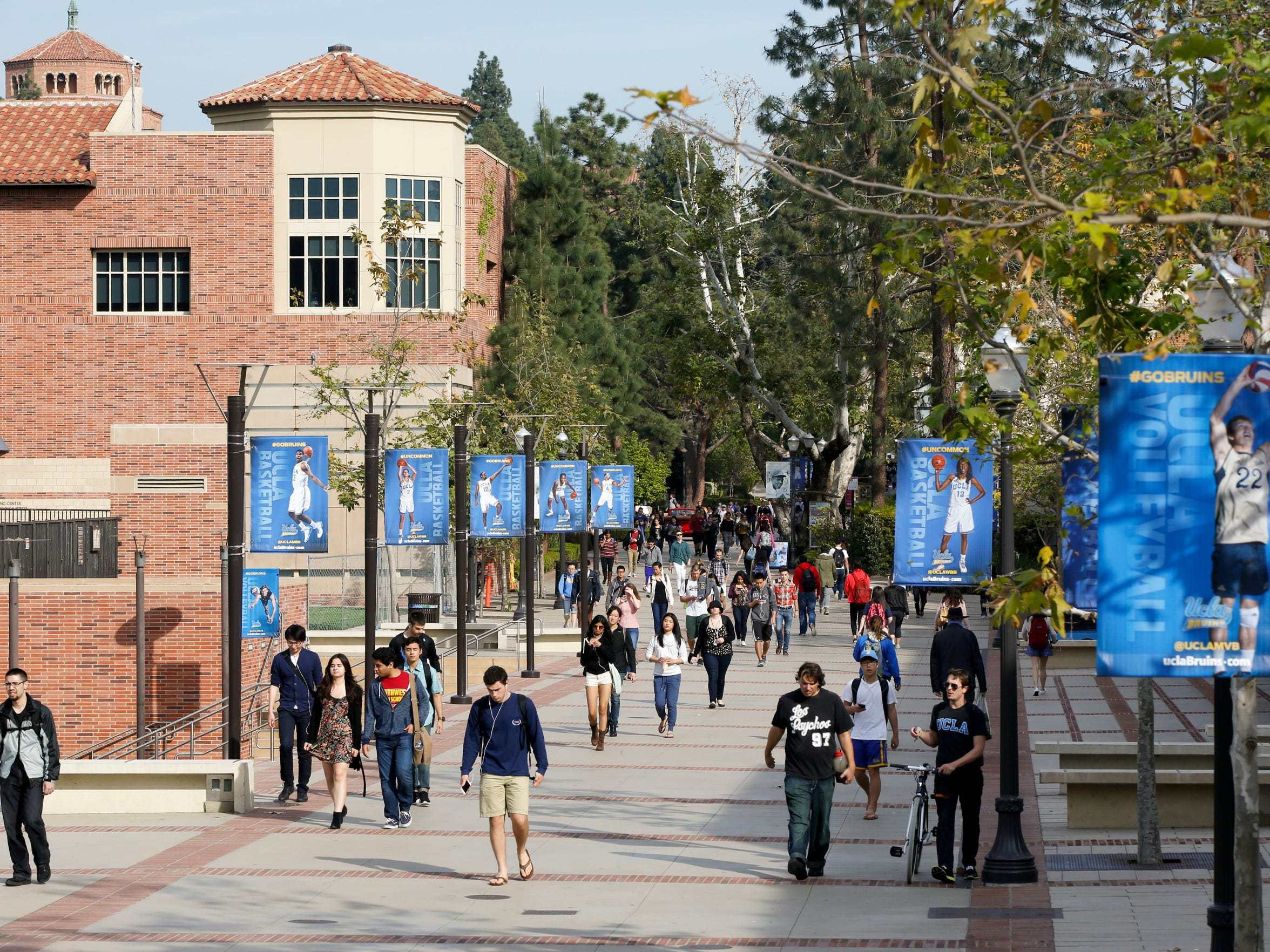 Students walk around the UCLA campus in Los Angeles, California on Feb. 26, 2015.