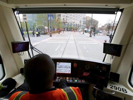 QLine street car operator Nate Baker drives around Campus Martius  on Woodward Avenue in Detroit on Tuesday, May 2, 2017.