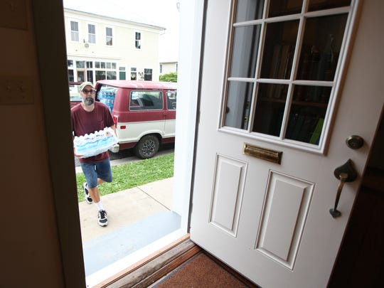 James Gardner delivers bottled water to the Monterey town offices on Monday, August 14, 2017 where he works after picking it up from a disaster relief organization in West Virginia. The town has been dealing with a water shortage for several days due to multiple issues with their water system. A state of emergency was declared and water had to trucked in for residents to use until repairs are completed to the well casings and water lines.