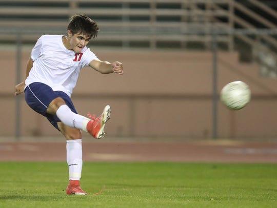 Jonathan Delgado of La Quinta shoots on goal against