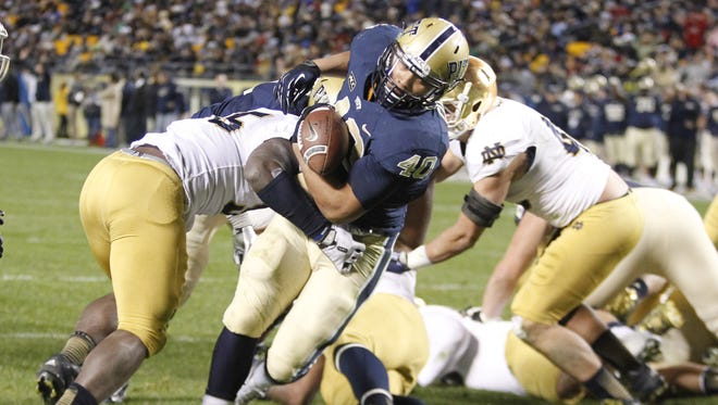 Pittsburgh Panthers running back James Conner rushes for a touchdown against the Notre Dame Fighting Irish during the fourth quarter at Heinz Field.