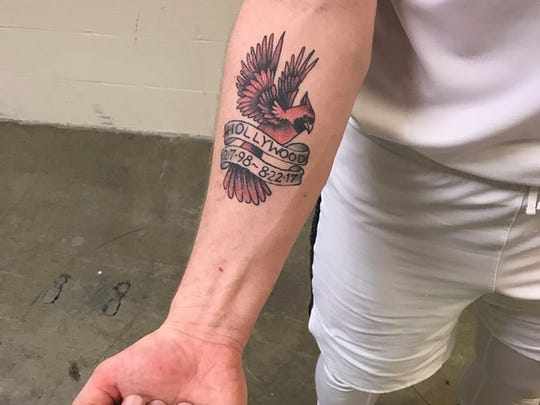 Ball State's Tayler Persons shows his tattoo honoring former teammate Zach Hollywood.
