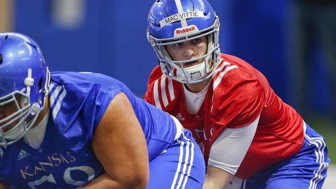 Senior Thomas MacVittie, right, is one of three players KU football head coach Les Miles mentioned when discussing the team's ongoing quarterback competition last Thursday. Miles also mentioned juniors Miles Kendrick and Miles Fallin.