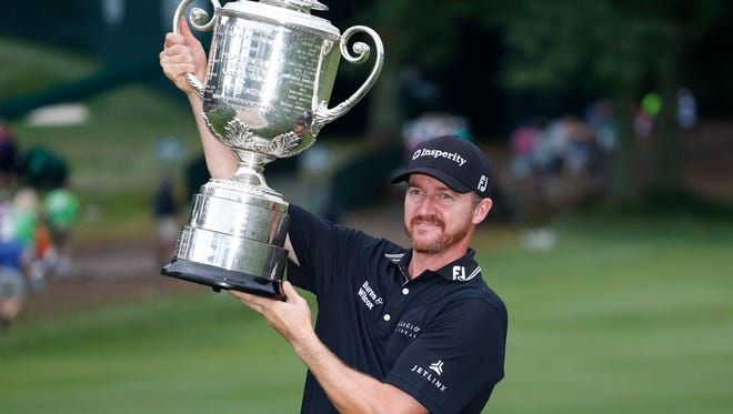 Jimmy Walker holds up the Wanamaker Trophy after winning the 2016 PGA Championship on Sunday.