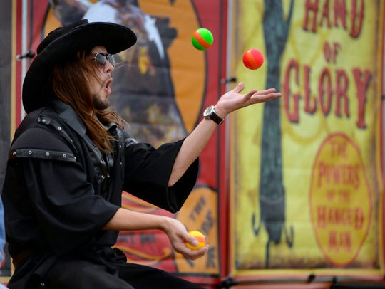 Joey Varner juggles during a previous Gulf Coast Renaissance Faire and Pirate Festival. This year's event is set for Saturday, March 3, in Milton.