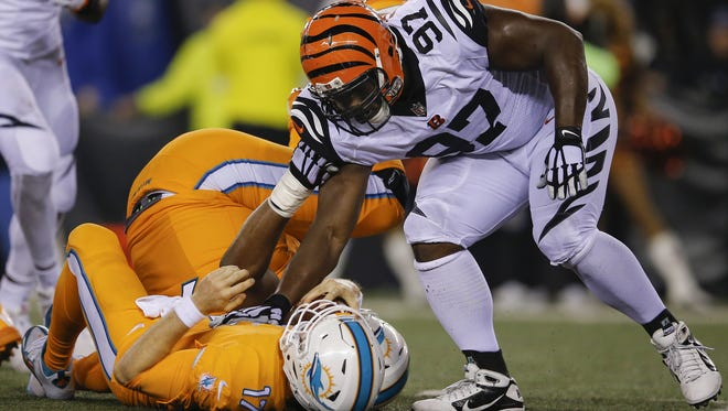 Cincinnati Bengals defensive tackle Geno Atkins (97) tags Miami Dolphins quarterback Ryan Tannehill (17) to officially record a sack during the NFL game between Miami Dolphins and the Cincinnati Bengals, Thursday, Sept. 29, 2016, at Paul Brown Stadium in Cincinnati.