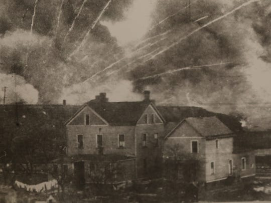 The Kingsland explosions created a towering plume of black smoke punctured by gold and silver streaks.