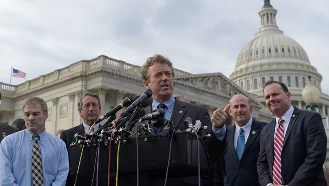 Sen. Rand Paul, R-Ky., center, joined by, from left, Rep. Jim Jordan, R-Ohio, Rep. Mark Sanford, R-S.C., Rep. Louie Gohmert, R-Texas, and Sen. Mike Lee, R-Utah, speaks about health care during a news conference on Capitol Hill in Washington, Tuesday, March 7, 2017.