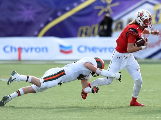 LAS VEGAS, NV - DECEMBER 20:  Quarterback Travis Wilson #7 of the Utah Utes avoids a tackle by linebacker Max Morgan #40 of the Colorado State Rams during the Royal Purple Las Vegas Bowl at Sam Boyd Stadium on December 20, 2014 in Las Vegas, Nevada.  (Photo by Ethan Miller/Getty Images)
