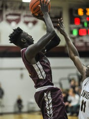 Reggie Tawiah of Matawan, left, shoots the ball over