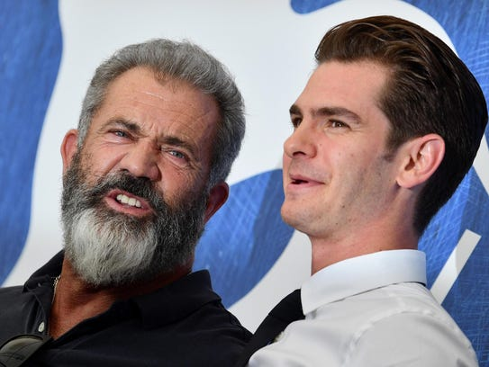 Mel Gibson (L) and  Andrew Garfield pose during a photocall