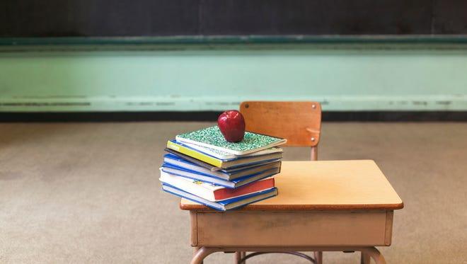 A School desk in a classroom.