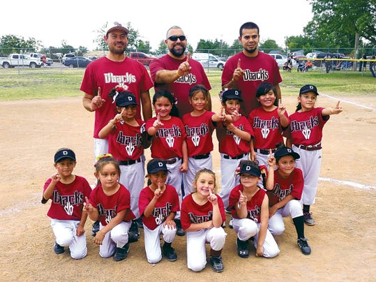 Submitted Photo   The Quarrell Surveying Diamondbacks rode high energy and peak play in capturing the tournament championship in the Deming Girls' Junior Coach-Pitch Softball League at the Lloyd Pratz Recreational Complex on Deming's eastside. The girls caught fire during the tournament and defeated the Nationals 29-26 to wrestle the crown away. Coaches are, from left, Miguel Echavarria, Manny Armendariz and Cesar Gonzalez. Standing, from left, are: Cristal Enriquez, Aylah Gonzalez, Jocelyn Carbajal, Emily Armendariz, Bailey Cordova and Mia Peña. Kneeling, from left, are: Julissa Echavarria, Angelica Cordova, Alexia Echavarria, Mia Homsi, Emely Chavez and Serenity Cook-Jordan.