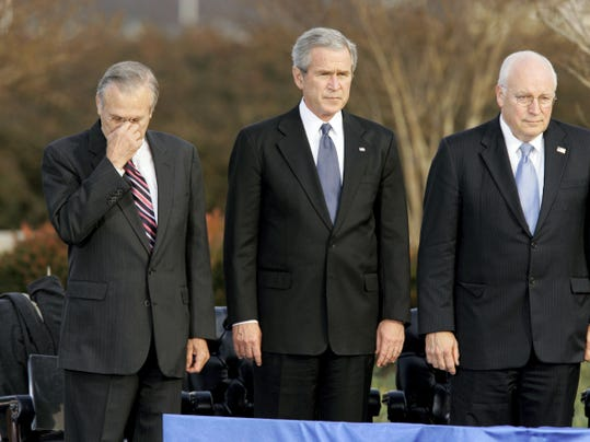 FILE - In this Friday, Dec. 15, 2006, file photo, Secretary of Defense Donald Rumsfeld, left, pauses as President George W. Bush, and Vice President Dick Cheney participate in Rumsfeld's farewell ceremony at the Pentagon in Washington. Former President George H.W. Bush is publicly criticizing for the first time key members of his son's administration. A biography of the nation's 41st president to be published in November, 2015, contains his sharply critical assessments of Cheney and Rumsfeld. (AP Photo/J. Scott Applewhite, File)