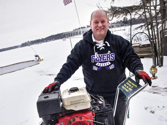 Chuck Zwilling stands next to a custom chainsaw rig in January 2018 at Green Prairie Fish Lake near Little Falls.