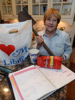 Tommie Sue Brooks of Bossier City says her necessary luxury items include a book bag from the Bossier City Library, an appointment book, her favorite coffee mug and community coffee and finally the shovel she uses in her garden.