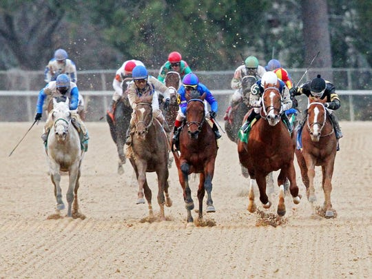 Discreetness, center, topped Gordy Florida, right, to win Monday's Smarty Jones Stakes at Oaklawn Park.