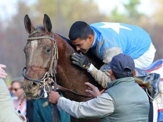 Jockey Luis Saez celebrates after a victory with Brody?s