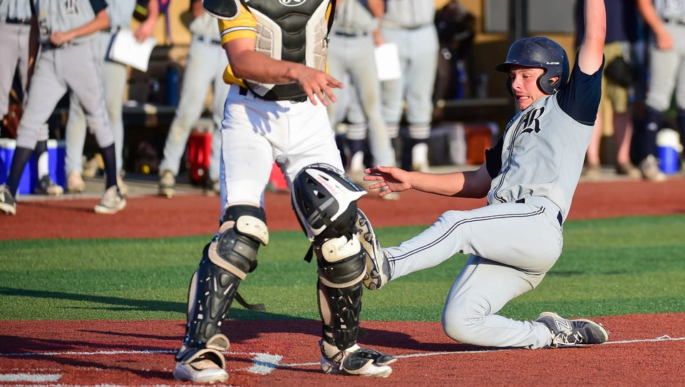 Roosevelt's Stephen Loew (3) slides into home as Southeast