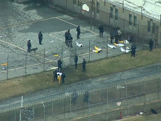 Inmates are contained at Vaughn Correctional Center near Smyrna after Building C was secured during a prison siege in February.
