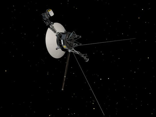 An image of one of the Voyager spacecraft in orbit.