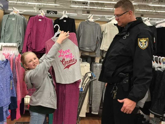 11-year-old Alison shows off some clothes to ESCO Deputy