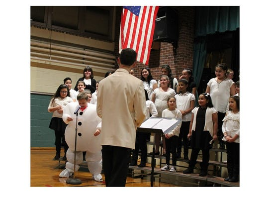 Faber School Choir members with our very own snowman.