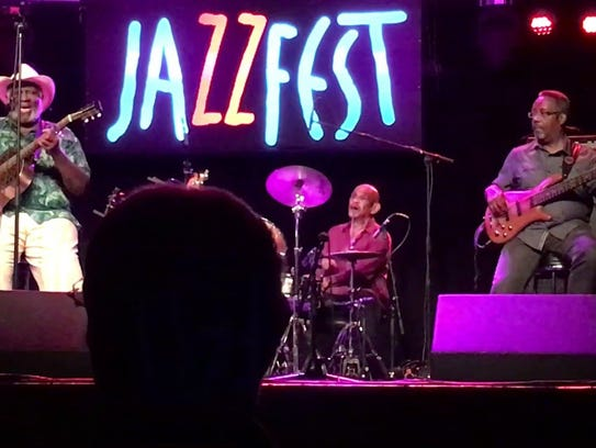 The Taj Mahal Trio (from left) are Taj Mahal, drummer