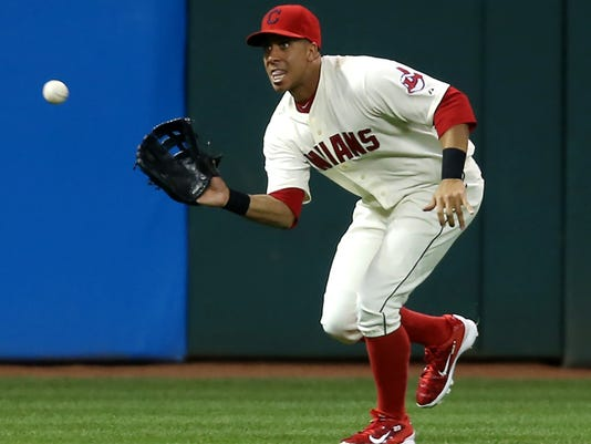 FILE - In this Sept. 19, 2015 file photo, Cleveland Indians outfielder Michael Brantley makes a running catch to put out Chicago White Sox's Micah Johnson during the third inning of a baseball game, in Cleveland. The Indians have placed Brantley on the 15-day disabled list because he's still having issues with his surgically repaired right shoulder. The team made the move Saturday, May 14, 2016, retroactive to May 10. Brantley has been bothered by inflammation in his shoulder, which he injured late last season while trying to make a diving catch in Minnesota. He had surgery in November.  (AP Photo/Ron Schwane, File)