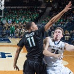 Notre Dame guard Pat Connaughton (24) goes up for a shot as Binghamton Bearcats guard Romello Walker (11) defends in the second half at the Purcell Pavilion. Notre Dame won 82-39.