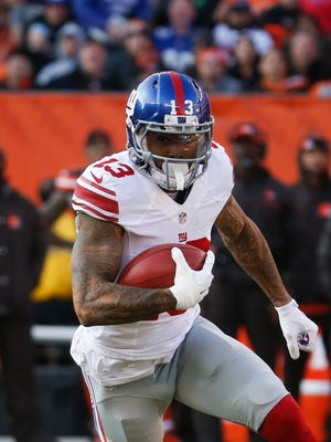 In  this Sunday, Nov. 27, 2016, photo, New York Giants wide receiver Odell Beckham Jr. runs the ball in the second half against the Browns in Cleveland. Beckham wants the ball any way he can get it. If that means the big-play wide receiver adds the job of returning punts for the New York Giants, he's up for it. (AP Photo/Ron Schwane)