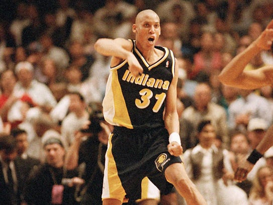 Indiana Pacers guard Reggie Miller celebrates at the