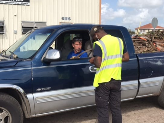 Josh Huggins, working for the city of Cape Coral, checks